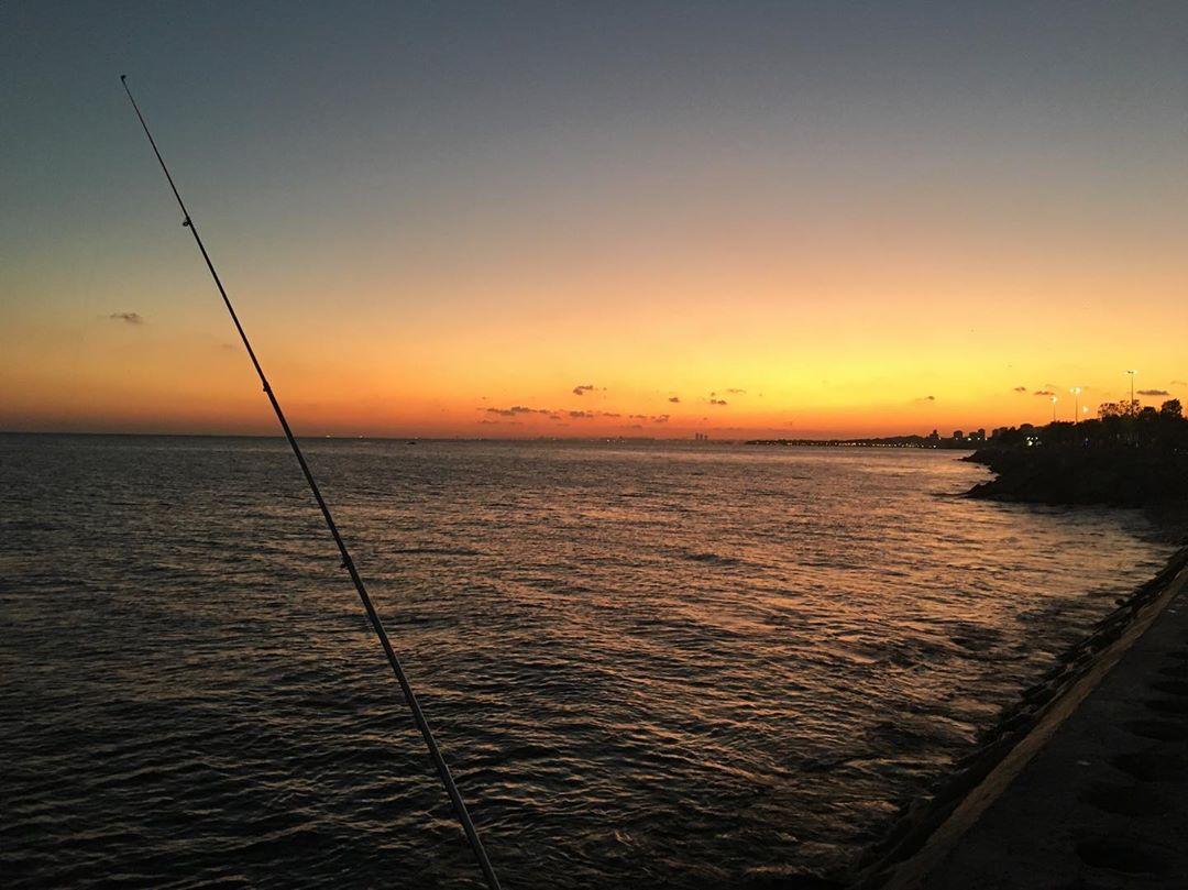 Gün Batımı ve Olta Balık Tutma Manzarası